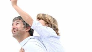 Close up of father giving son piggyback ride
