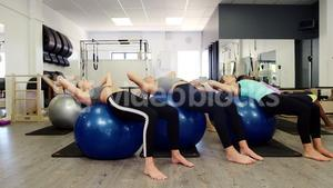 Beautiful women exercising in fitness studio