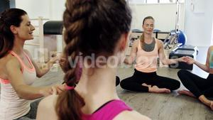 Beautiful women doing relaxation exercise in fitness studio