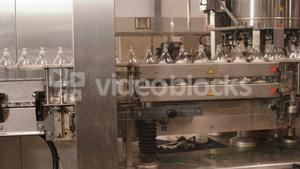 Bottles moving in production line