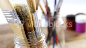 Various paintbrush in glass container