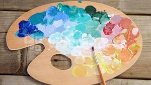 Watercolor paint with wooden palette and paintbrush