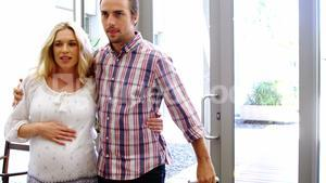 Pregnant woman walking in hospital with her husband