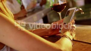 Woman using mobile phone in restaurant
