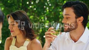 Couple drinking wine at outdoor restaurant