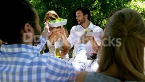 Group of friends enjoying meal at outdoor lunch