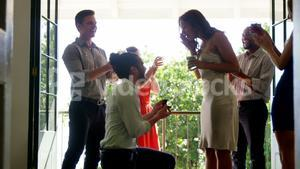 Man proposing woman with ring by kneeling down
