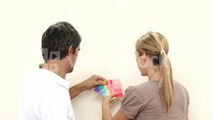 Couple choosing colours to paint new house