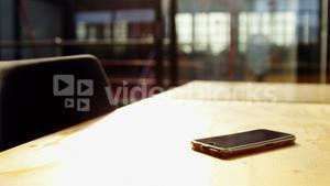 Smart phone on the desk in office