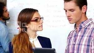 Business executives discussing over digital tablet in meeting