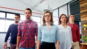 Business executives walking together in office
