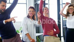 Business executives dancing in office