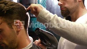 Man getting his hair dried with hair dryer