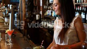 Portrait of barmaid cleaning bar counter
