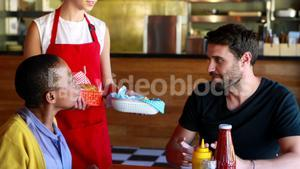 Waitress serving food to customers