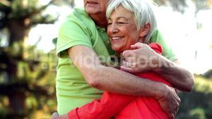 Senior couple embracing in park