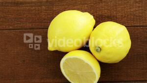Full and half lemons on table