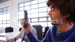 Male business executive talking on telephone