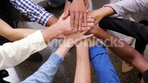 Hands of business team stacking their hands together
