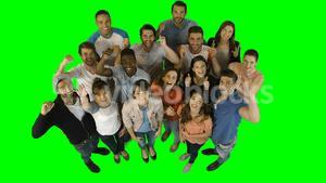 Excited business executives standing against green screen