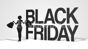 Woman with shopping bags dancing beside Black Friday sale sign