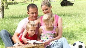 Parents and children reading in a park