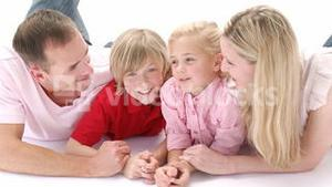 Family lying on floor and talking