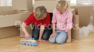 Children playing with a train after moving house