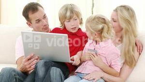 Happy family buying online at home
