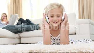 Little girl listening to the music in the livingroom