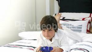 Boy on his bed playing video games