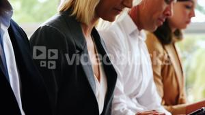 Business executives using mobile phone