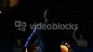 Rear view of male business executive giving a speech