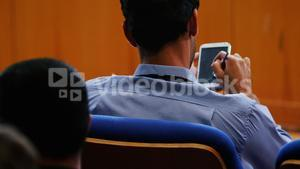 Business executives participating in a business meeting using digital tablet