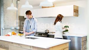 Couple working in kitchen