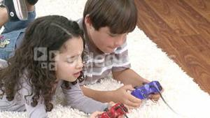Children playing video games in the livingroom