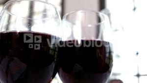 Close-up of two red wine glasses