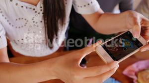 Woman clicking photo of food on mobile phone