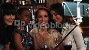 Friends taking a selfie at bar counter