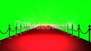 Red carpet with spotlights against green background