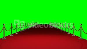 Long red carpet against green background