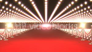 Long red carpet with spotlights against red background