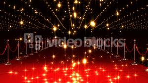 Golden confetti falling on red carpet  against black background