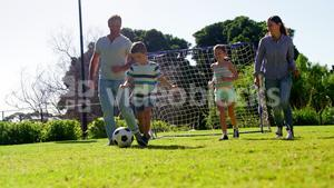 Happy family playing football