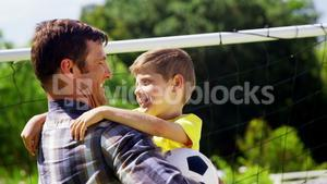 Father embracing his son in park