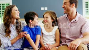 Family relaxing on sofa in living room