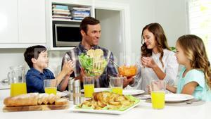 Family having healthy meal together at home