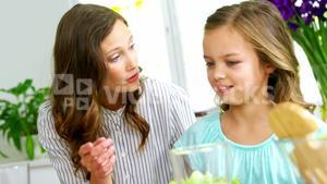 Mother and daughter having healthy meal