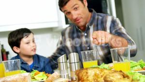Father and son having healthy meal