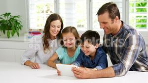 Happy family using digital tablet